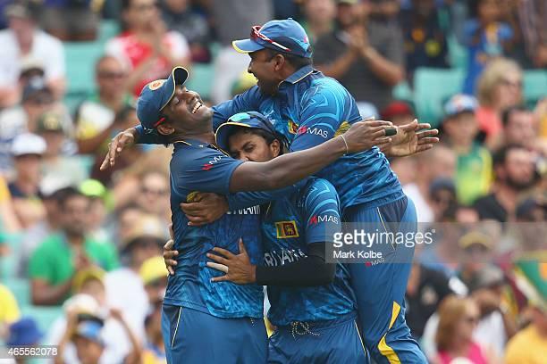 Thisara Perera, Dinesh Chandimal and Mahela Jayawardene of Sri Lanka celebrate after Perera took the catch to dismiss Steve Smith of Australia during...