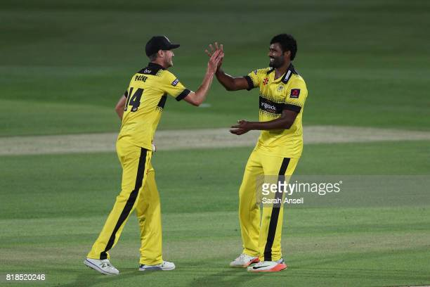 Thisara Perera of Gloucestershire celebrates with teammate David Payne after bowling James Tredwell of Kent Spitfires to wrap up victory at the end...