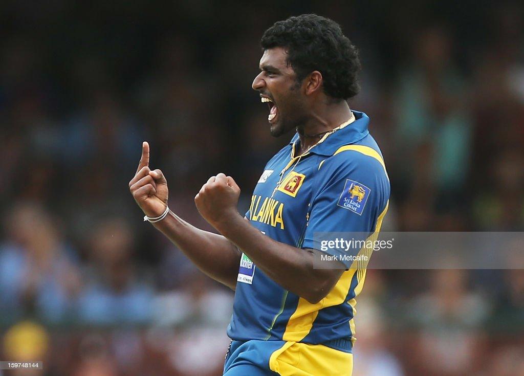 Thisara Perera of Sri Lanka celebrates taking the wicket of David Warner of Australia during game four of the Commonwealth Bank one day international series between Australia and Sri Lanka at Sydney Cricket Ground on January 20, 2013 in Sydney, Australia.