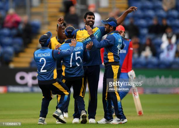 Thisara Perera of Sri Lanka celebrates taking the wicket of Mohammad Nabi of Afghanistan with his teammates during the Group Stage match of the ICC...