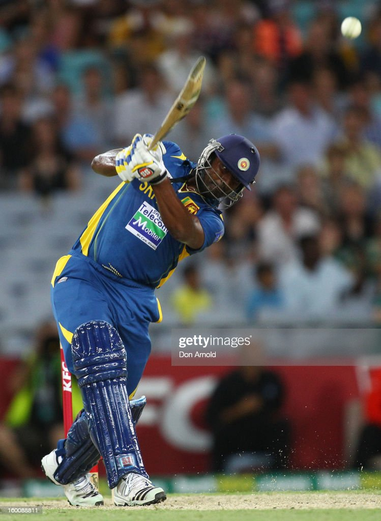 Thisara Perera of Sri Lanka hits a six to win the match during game one of the Twenty20 international match between Australia and Sri Lanka at ANZ Stadium on January 26, 2013 in Sydney, Australia.