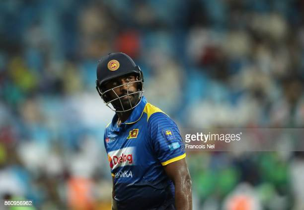 Thisara Perera of Sri Lanka leave the field after being dismissed by Shadab Khan of Pakistan during the first One Day International match between...