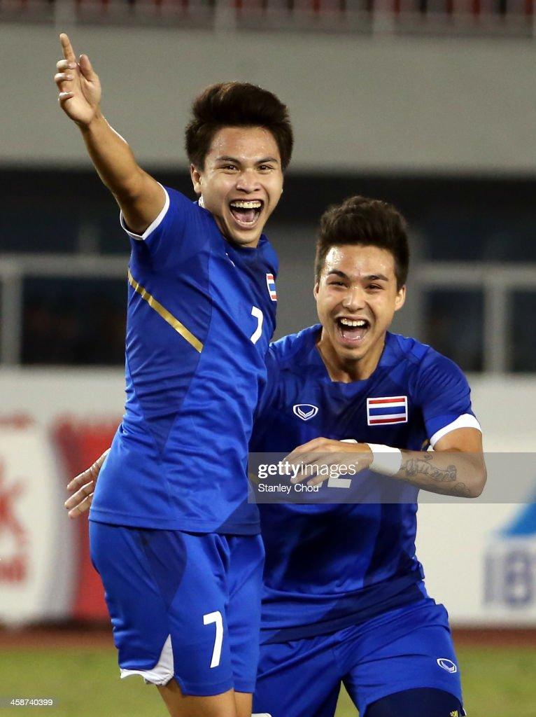 Thitiphan Puangjan #7 and Charyl Yannic of Thailand celebrates Thailand first goal against Indonesia during the Men's Football Final Competition between Indonesia and Thailand during the 2013 SEA Games at the Zeyar Thiri Stadium on December 21, 2013 in Nay Pyi Taw, Burma.