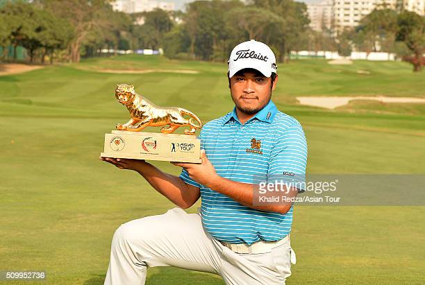 Thitiphun Chuayprakong of Thailand posing with the championship trophy after round four of the Bashundhara Bangladesh Open at Kurmitola Golf Club on...