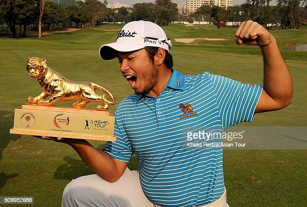 Thitiphun Chuayprakong of Thailand posing with the championship trophy after the round four of the Bashundhara Bangladesh Open at Kurmitola Golf Club...