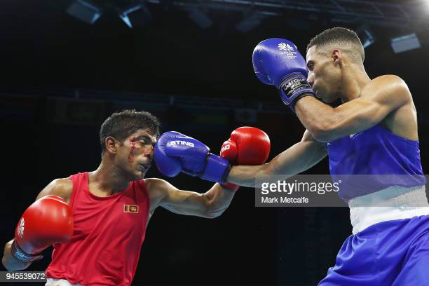 Thiwanka Ranasinghe of Sri Lanka and Galal Yafai of England compete in their Men's Light Fly 4649kg Semifinal bout during Boxing on day nine of the...