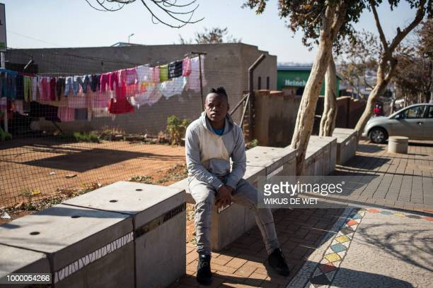 Thobane Mkhize speaks about the legacy of antiapartheid icon Nelson Mandela in Soweto on July 11 2018 A black and white photo of Nelson Mandela in...