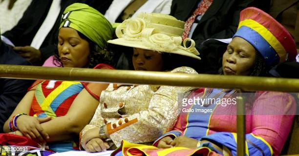 Thobeka Mabhija Nompumelelo Ntuli and Sizakele Khumalo wives of President Jacob Zuma attend as he presents his State of the Nation Address at a joint...