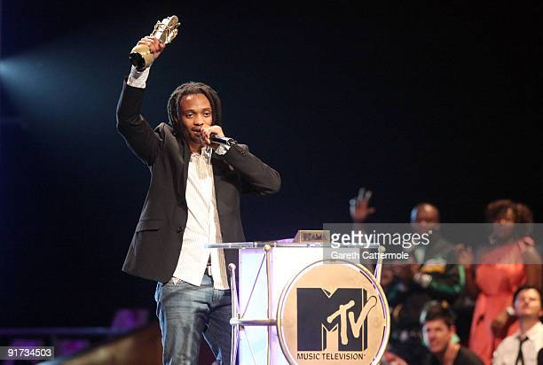 Thokozani Dube accepts the Legend Award won by his late father Lucky Dube at the MTV Africa Music Awards with Zain at the Moi International Sports...