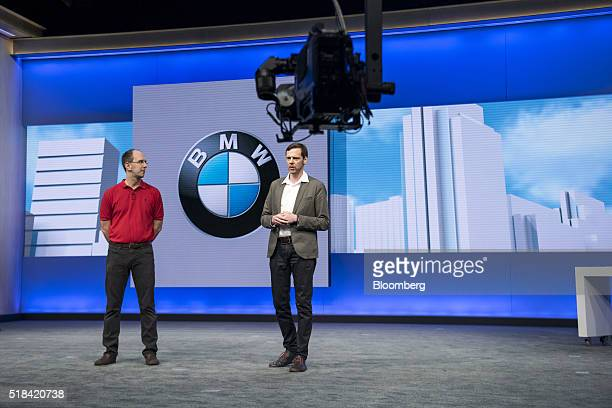 Thom Brenner vice president of digital life for BMW Group right speaks as Scott Guthrie executive vice president of the cloud and enterprise group at...