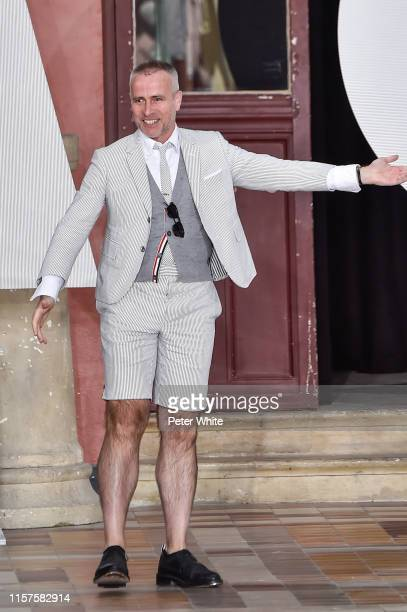 Thom Browne acknowledges the applause of the public after the Thom Browne Menswear Spring Summer 2020 show as part of Paris Fashion Week on June 22,...