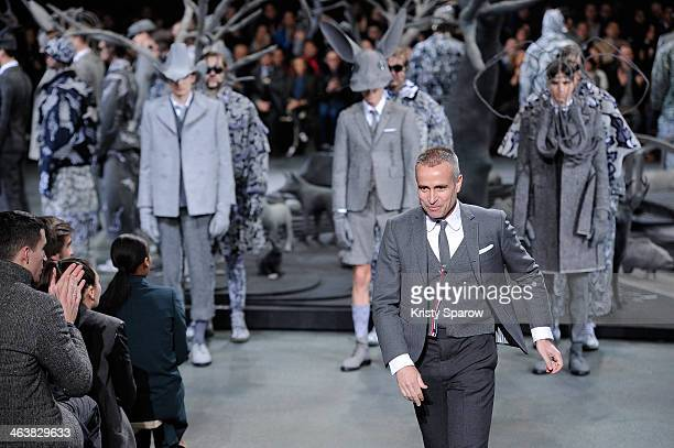 Thom Browne acknowledges the audience during the Thom Browne Menswear Fall/Winter 2014-2015 show as part of Paris Fashion Week on January 19, 2014 in...