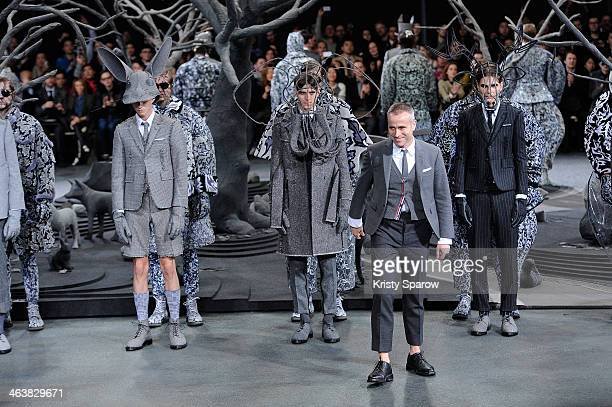 Thom Browne acknowledges the audience during the Thom Browne Menswear Fall/Winter 20142015 show as part of Paris Fashion Week on January 19 2014 in...