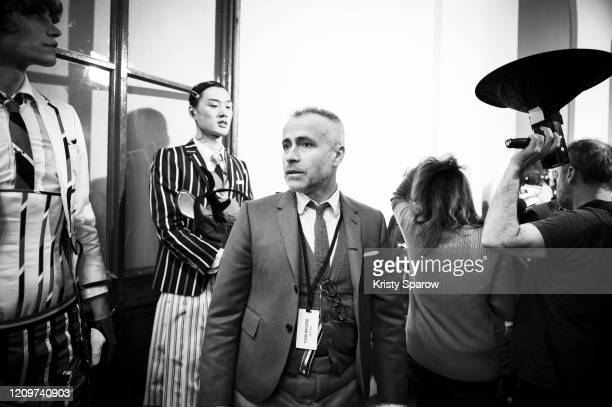 Thom Browne prepares a model backstage before the Thom Browne Womenswear Fall/Winter 2020/2021 show as part of Paris Fashion Week on March 01, 2020...