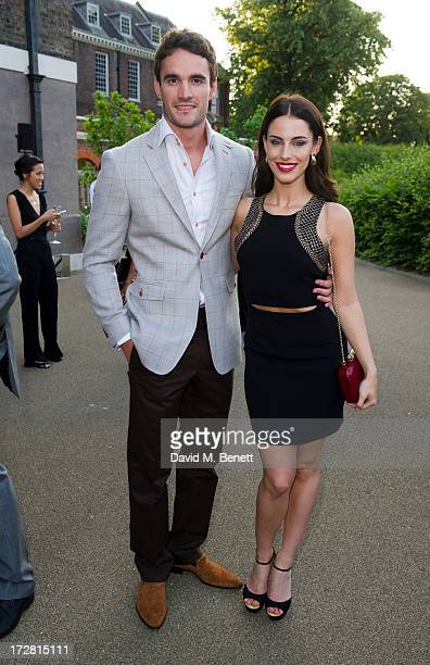 Thom Evans and Jessica Lowndes attend a private view of 'Fashion Rules' a new exhibition featuring a rare collection of dresses worn by Queen...
