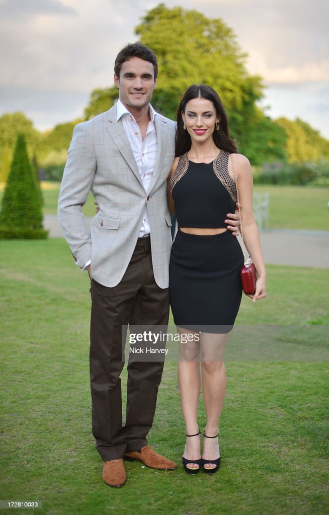 Thom Evans and Jessica Lowndes attend the launch party for the Fashion Rules exhibition, a collection of dresses worn by HRH Queen Elizabeth II, Princess Margaret and Diana, Princess of Wales at Kensington Palace on July 4, 2013 in London, England.