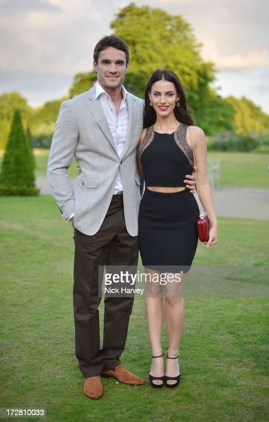 Thom Evans and Jessica Lowndes attend the launch party for the Fashion Rules exhibition a collection of dresses worn by HRH Queen Elizabeth II...