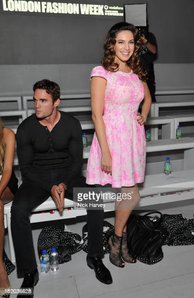 Thom Evans and Kelly Brook attend the front row for the Issa London show on day 2 of London Fashion Week Spring/Summer 2013 at The Courtyard Show...