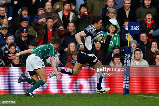 Thom Evans of Scotland gets past Ronan O'Gara of Ireland to score a try during the RBS Six Nations Championship match between Scotland and Ireland at...