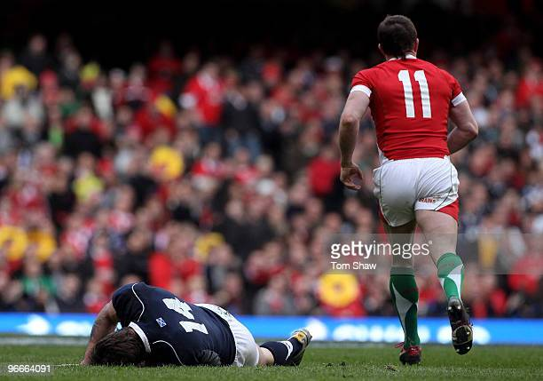 Thom Evans of Scotland lies injured on the field during the RBS 6 Nations match between Wales and Scotland at the Millennium Stadium on February 13...