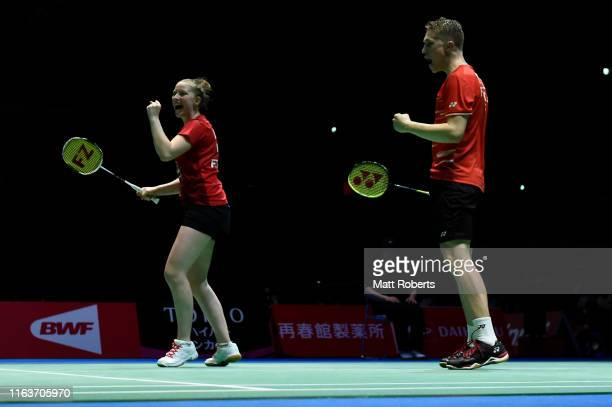Thom Gicquel and Delphine Delrue of France celebrate against Tontowi Ahmad and Winny Oktavina of Indonesia during day one of the Daihatsu Yonex Japan...