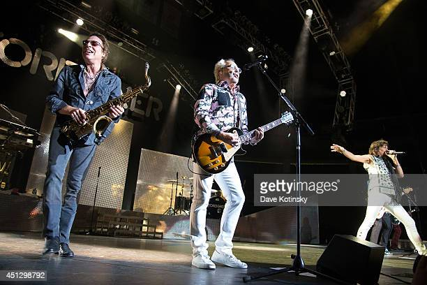 Thom Gimbel of the group Foreigner and Mick Jones of the group Foreigner performs at Prudential Center on June 26 2014 in Newark New Jersey