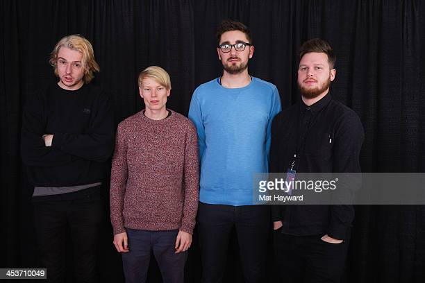 Thom Green Gwil Sainsbury Gus UngerHamilton and Joe Newman of AltJ pose for a portrait backstage during Deck the Hall Ball hosted by 1077 The End at...