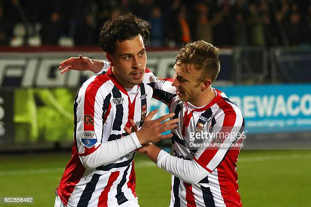 Thom Haye of Willem II celebrates scoring his teams third goal of the game in the final seconds with team mates during the Dutch Eredivisie match...