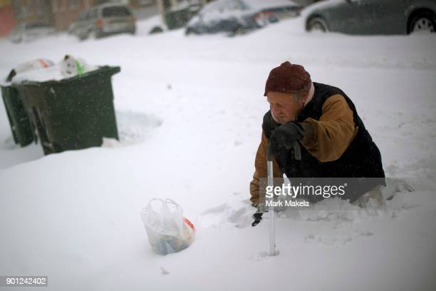Thom Meyers trudges with a cane through snow covered streets on January 4 2018 in Atlantic City New Jersey A Òbomb cycloneÓ winter storm has caused...