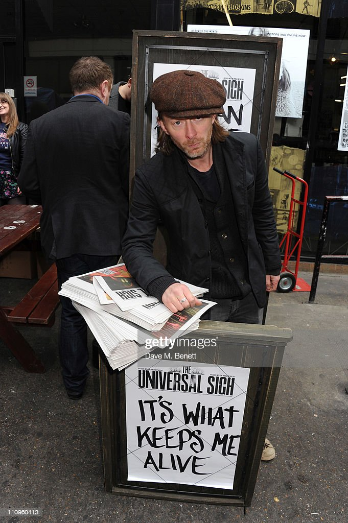 Thom Yorke celebrated the physical release of the new Radiohead album 'The King of Limbs' and shocked fans who had queued for hours by handing out the first few hundred copies of Radiohead's free newspaper 'The Universal Sigh' himself outside RoughTrade's Brick Lane store on March 28, 2011 in London, England.