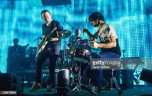 Thom Yorke Phil Selway and Jonny Greenwood of Radiohead perform at the 02 Arena on October 8 2012 in London England
