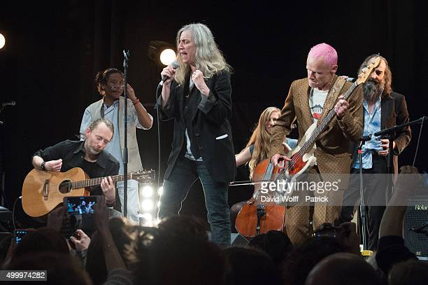 Thom Yorke Tenzin Choegyal Patti Smith Rebecca Foon Flea and Warren Ellis perform during Pathway to Paris at Le Trianon on December 4 2015 in Paris...