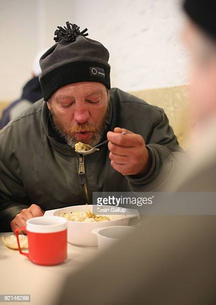 Thomas a homeless man who has been unemployed since 1997 eats hot soup at a soup kitchen of the Malteser charity part of the Order of Malta Worldwide...