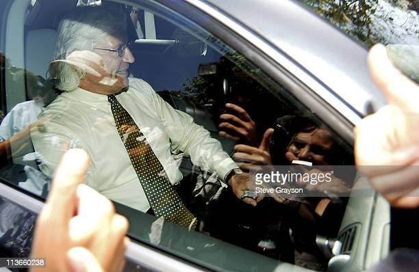 Thomas A Mesereau Jr receives thumbsup from fans as he enters the gates Michael Jackson's Neverland Ranch in Los Olivos California after Jackson was...