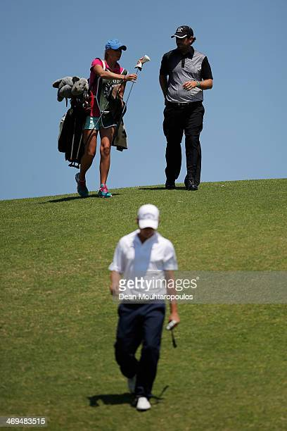 Thomas Aiken of South Africa and his caddie Kate Aiken walk on the 5th hole during Day 3 of the Africa Open at East London Golf Club on February 15...