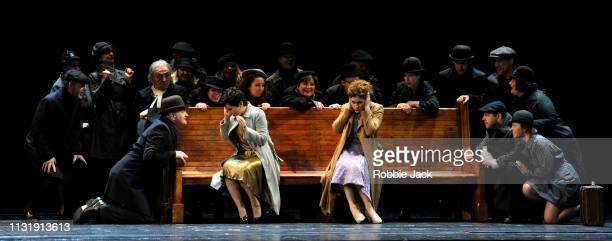 Thomas Allen as Don Alfonso Salome Jicia as Fiordiligi and Serena Malfi as Dorabella with artists of the company in The Royal Opera's production of...