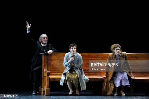 Thomas Allen as Don Alfonso Salome Jicia as Fiordiligi and Serena Malfi as Dorabella inThe Royal Opera's production of Wolgang Amadeus Mozart's Cosi...