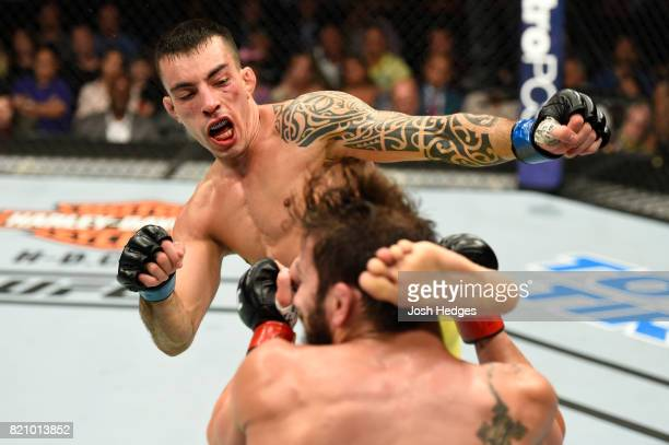 Thomas Almeida of Brazil kicks Jimmie Rivera in their bantamweight bout during the UFC Fight Night event inside the Nassau Veterans Memorial Coliseum...