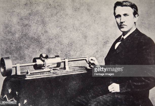 Thomas Alva Edison sitting beside his invention the phonograph 1878 Dubbed The Wizard of Menlo Park by a newspaper reporter Edison was one of the...