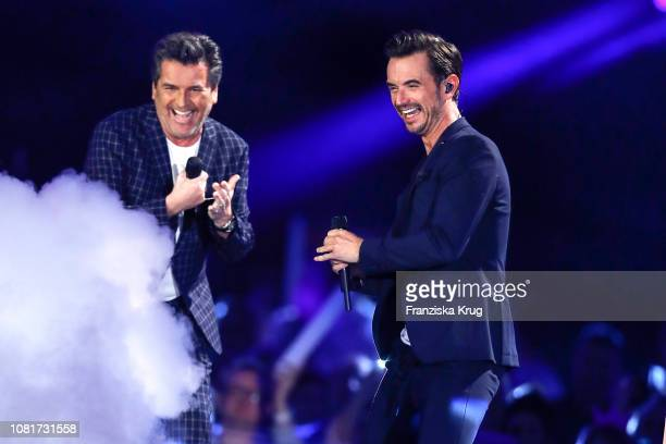 Thomas Anders and Florian Silbereisen during the television show 'Schlagerchampions - Das grosse Fest der Besten' at Velodrom on January 12, 2019 in...