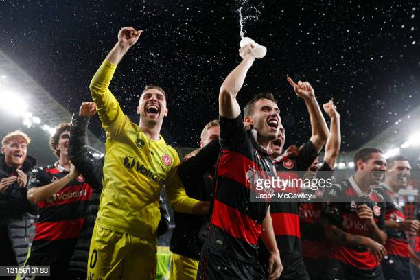 Thomas Aquilina of the Wanderers and Daniel Margush of the Wanderers celebrate victory during the A-League match between Western Sydney Wanderers and...