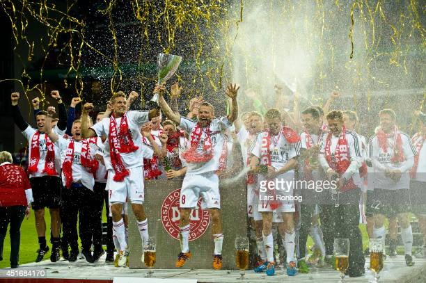 Thomas Augustinussen and Rasmus Würtz of AaB Aalborg lifts the trophy after the DBU Pokalen Cup Final match between AaB Aalborg and FC Copenhagen in...