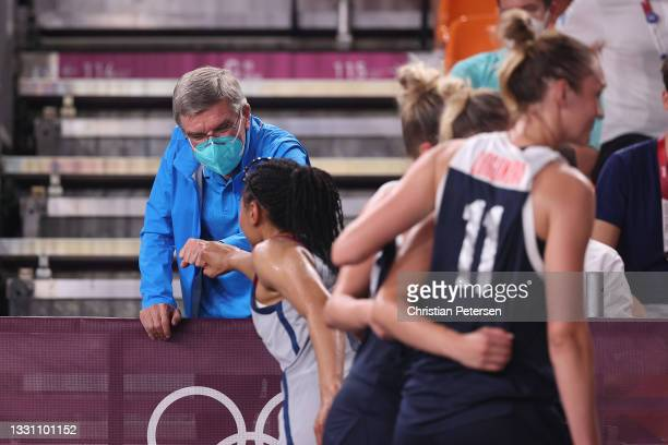 Thomas Bach, IOC President congratulates Allisha Gray of Team United States after their gold medal victory in the 3x3 Basketball competition on day...