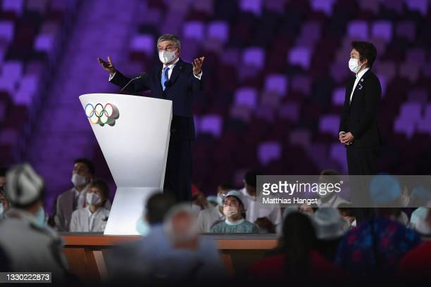 Thomas Bach, IOC President makes a speech as Seiko Hashimoto, Tokyo 2020 President looks on during the Opening Ceremony of the Tokyo 2020 Olympic...