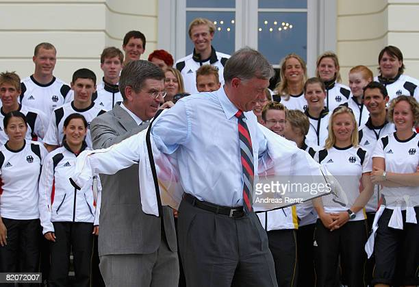 Thomas Bach president of the German Olympic Sports Association DOSB hands over a German Olympic jacket to German President Horst Koehler at Schloss...