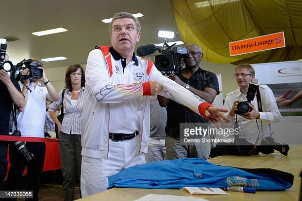 Thomas Bach president of the German Olympic Sports Federation DOSB tries the german team's clothing collection during the London 2012 kitting out of...