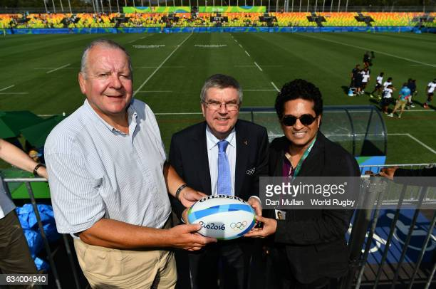 Thomas Bach President of the International Olympic Committee is presented with a match ball by Bill Beaumont Chairman of World Rugby via Getty Images...