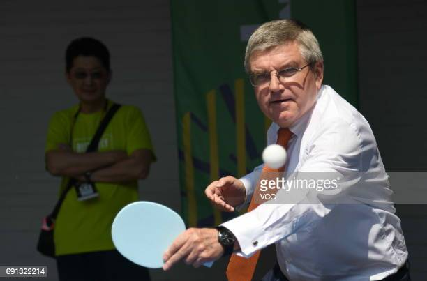 Thomas Bach, president of the International Olympic Committee , plays table tennis as he visits World Table Tennis Championships at Messe Duesseldorf...