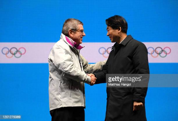 Thomas Bach, President of the International Olympic Committee shakes hands with Sungho Kim, Vice-Governor of Gangwon during the closing ceremony on...