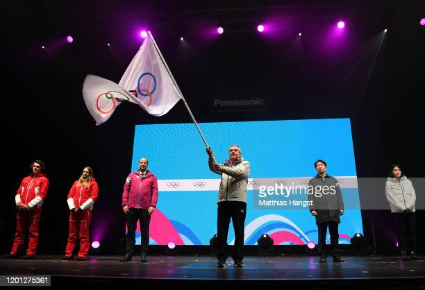 Thomas Bach, President of the International Olympic Committee waves the Olympic flag during the closing ceremony on day 13 of the Lausanne 2020...